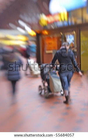 A motion and lens burred image of people moving