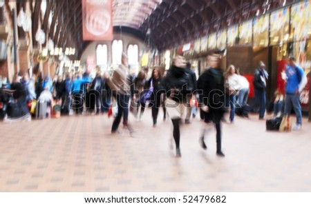 A motion and lens burred image of people traveling - stock photo