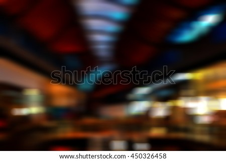 A motion blur of a shopping centre or mall.