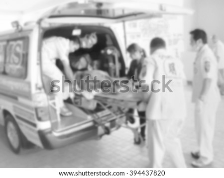 A motion blurred photograph of rescue Team Providing First Aid - stock photo
