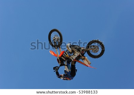 A motorcycle rider getting air while doing a stunt. - stock photo