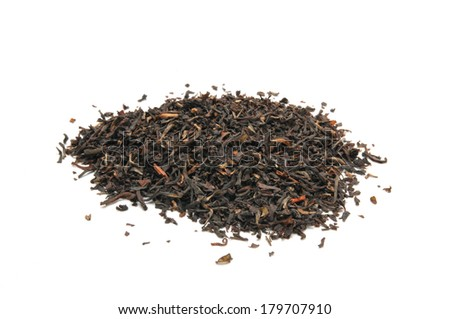 A mound of organic whole leaf black tea on a white background