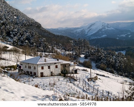 A mountain lodge covered by snow, winter season - stock photo