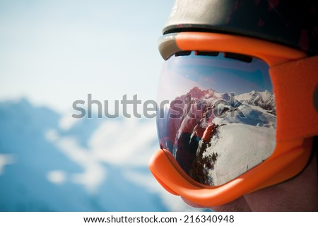 A mountain range reflected in the ski mask - stock photo