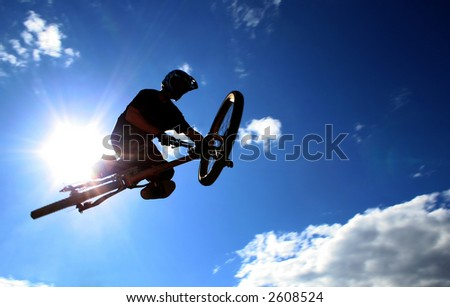 A mountainbiker flys across the sky during a freeriding contest held in Whistler, BC.