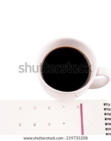 A mug of coffee and table day planner