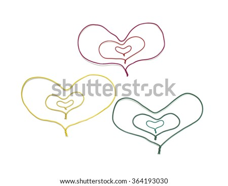 a multi colored cable,heart shape/colored hearts - stock photo