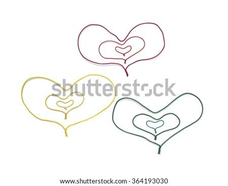 a multi colored cable,heart shape/colored hearts - stock photo