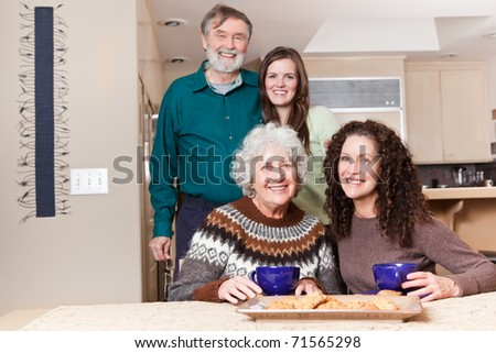 A multi generation portrait of happy grandparents with their daughter and granddaughter spending time together
