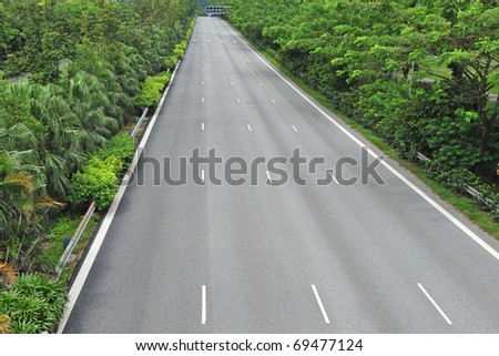 A Multi Lane Expressway Lined By Trees