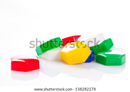 a multicolored plastic mosaic toy on white