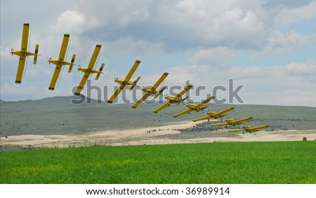 A multiple frame photo of a crop duster reveals the motion of flight. - stock photo
