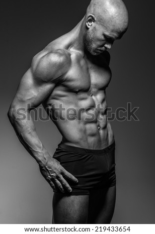 a muscular athletic male - stock photo
