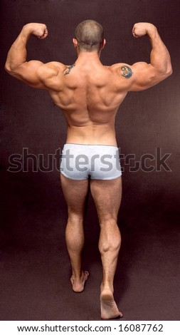 a muscular man posing artistic, back double biceps - stock photo