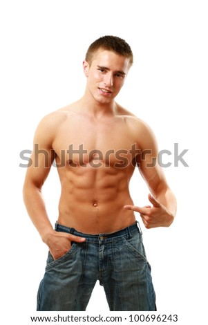 A muscular man showing his abs, isolated on white