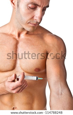 a muscular man with a syringe - stock photo