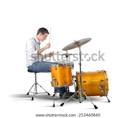 A musician plays his drums with passion - stock photo