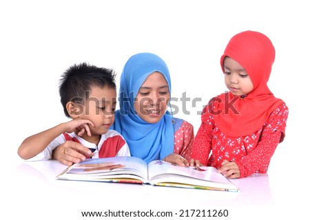 A Muslim Mother teaching his little children reading with white background. Family Education concept. - stock photo