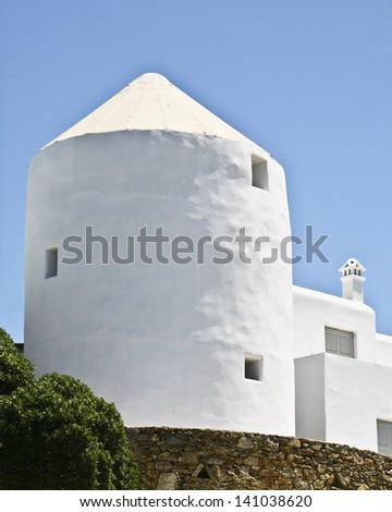 A Mykonos Windmill House - stock photo