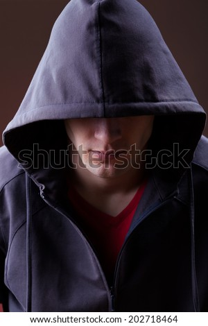 A mysterious man wearing a hooded jumper - stock photo