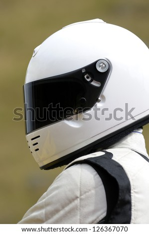 A mystery racing driver in a white suit. - stock photo