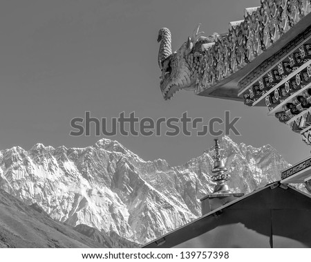 A mythical dragon guards the gate of the Tengboche Monastery - Everest region, Nepal, Himalayas (black and white) - stock photo