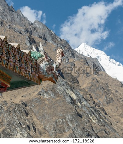 A mythical dragon guards the gate (right). Tengboche monastery - Nepal, Himalayas - stock photo