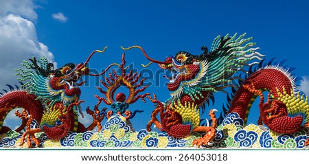 a mythical monster like a giant reptile. In European tradition the dragon is typically fire-breathing and tends to symbolize chaos or evil. - stock photo