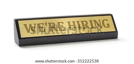 A name plate on a white background with the engraving We are hiring - stock photo