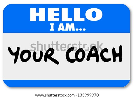 A namtag sticker with the words Hello I Am Your Coach to represent your life advisor, mentor, manager, leader or other person offering moral support or help - stock photo