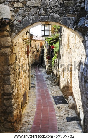 A narrow alley in the picturesque mountain top village of Eze near Monaco in France. - stock photo