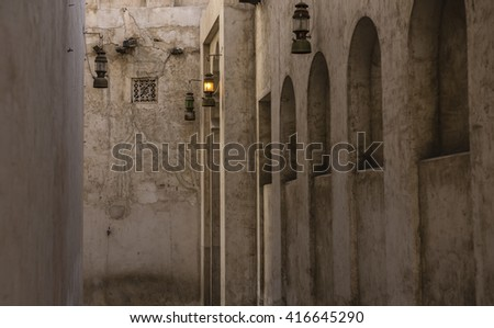 A narrow passage of an old building. Rustic Islamic architectural details. - stock photo