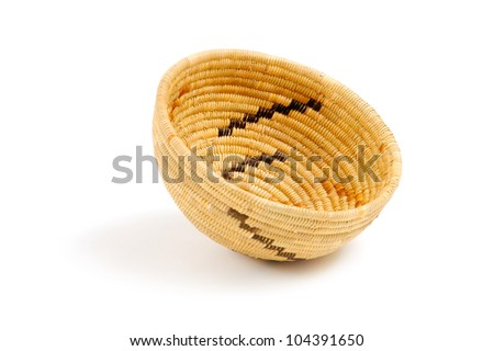 A Native American woven basket, edge view - stock photo