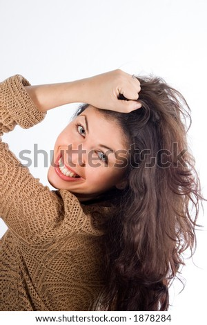 A naturally pretty young woman holding hair - See more in portfolio
