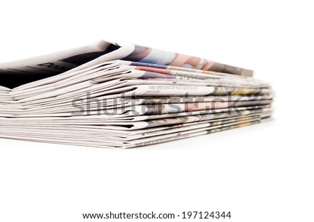 A neat stack of newspapers on top of each other. - stock photo