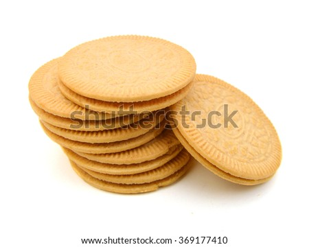 A neat stack of vanilla sandwich cookies - stock photo