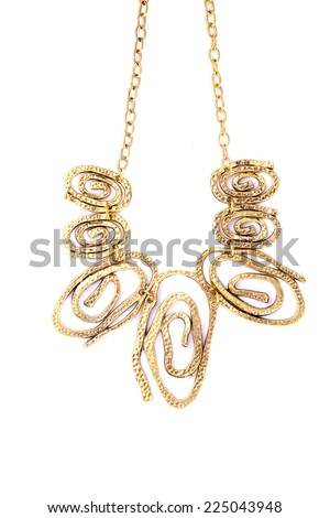 A necklace with crazy circles handing on the chain.