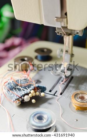 a needle of sewing machine closeup - stock photo