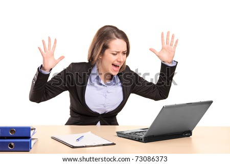 A nervous young businesswoman yelling isolated on white background - stock photo