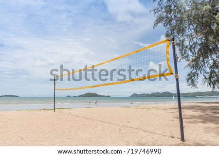 A net of beach volleyball in sunny day with white cloud and blue sky background.