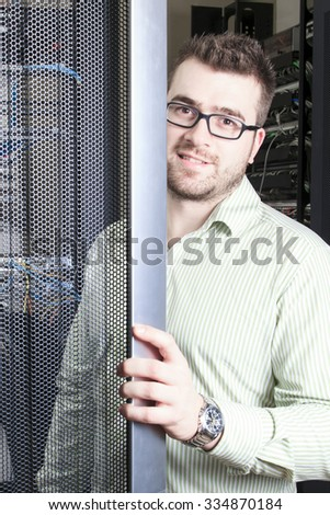 A network engineer working in server room. - stock photo