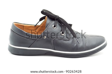 a new black man's shoes on a white background
