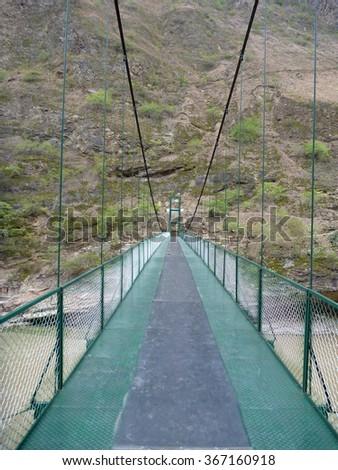 a new bridge over rio apurimac in peru - stock photo
