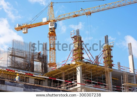 A New building is being constructed with use of tower crane - stock photo