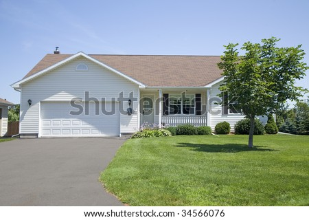 A new bungalow in a subdivision. - stock photo