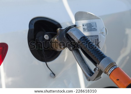 a new car on gas station - stock photo