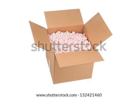 A new cardboard box full of pink protective packaging peanuts ready for shipping.