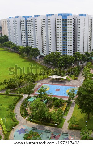 A new colorful neighborhood estate with tennis court and playground.  - stock photo