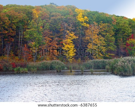 A New England lake in the fall - stock photo