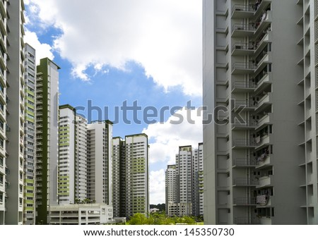 A new estate with a garden in the center. - stock photo